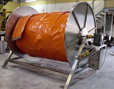 Oil containment boom reel with power pack
