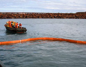 Fence oil spill boom in harbour
