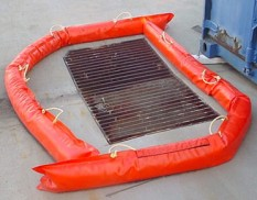 Urethane spill barrier around drain