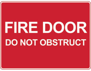 Fire door sign - fire door do not obstruct