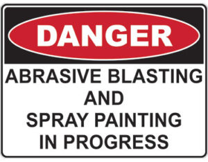 Danger abrasive blasting and spray painting in progress - safety sign