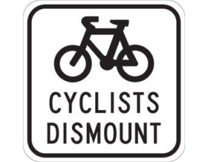 Cyclists dismount sign - class 1 retroreflective Australian standard aluminium or metal guide sign. Features white curved-edge rectangle background
