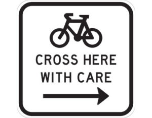 Bicycles cross right sign - class 1 retroreflective Australian standard aluminium or metal guide sign. Features white curved-edge rectangle background