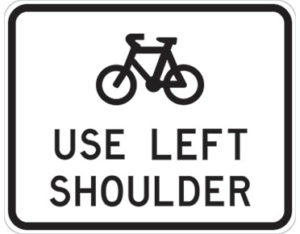 Bicycles left shoulder sign - class 1 retroreflective Australian standard aluminium or metal guide sign. Features white curved-edge rectangle background