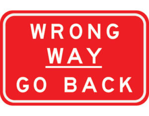 Wrong way sign - class 1 retroreflective Australian standard aluminium or metal guide sign. Features red curved-edge rectangle background