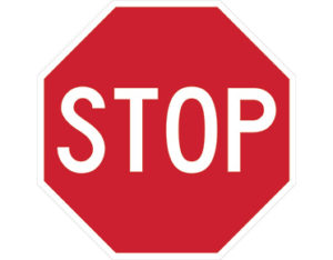 Stop sign features text STOP in bold white font on a red background.
