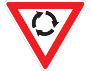 Road rounabout sign - symbol with red inverted triangle