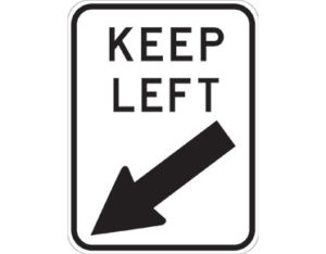 Road keep left sign - KEEP LEFT text with black arrow