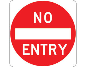 Road no entry sign - white NO ENTRY text with red circle