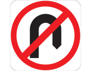 Road no u-turn sign - black u-turn symbol with red annulus and slash symbol