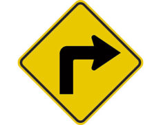 Turning right warning sign - class 1 retroflective road sign made to Australian standard features yellow diamond shape with black arrow