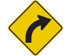 Curve right sign - class 1 retroflective road sign made to Australian standard features yellow diamond shape with black arrow