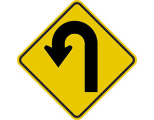 Left hairpin bend sign -class 1 retroflective road sign made to Australian standard features yellow diamond shape with u-shaped arrow