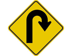 Right hairpin bend sign -class 1 retroflective road sign made to Australian standard features yellow diamond shape with u-shaped arrow