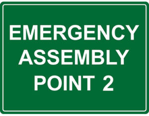Emergency point 2 sign for workplace safety by Global Spill Control