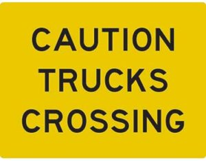 Caution trucks crossing swing stand sign